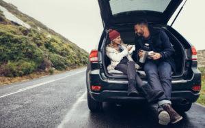 Header-Couple-in-Car-in-Wilderness